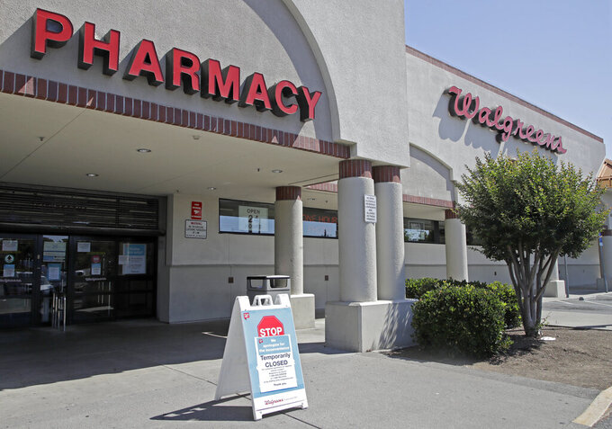 A sign alerting customers to a closed Walgreens store is seen on Wednesday, June 3, 2020, in Vallejo, Calif. A person was shot by police when people began breaking into stores late Monday, and another round of violence erupted late Tuesday, June 2, 2020. The shooting occurred when a group that had entered a Walgreens rammed a police officer outside, City Manager Greg Nyhoff said in a statement, he did not say whether the suspect survived. (AP Photo/Ben Margot)