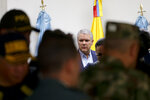 Colombia's President Ivan Duque arrives to speak to journalists before departing to attend the U.N. General Assembly from the CATAM air base in Bogota, Colombia, Saturday, Sept. 21, 2019. (AP Photo/Ivan Valencia)