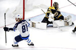Winnipeg Jets left wing Kyle Connor (81) raises his stick after his goal off Boston Bruins goaltender Jaroslav Halak, right, during the third period of an NHL hockey game in Boston, Tuesday, Jan. 29, 2019. (AP Photo/Charles Krupa)