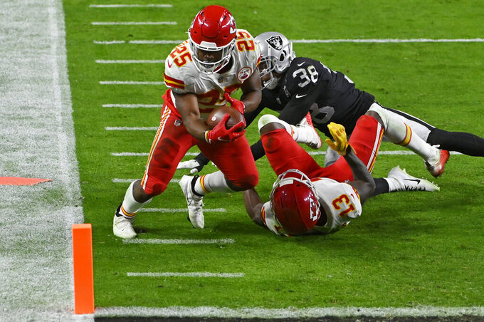 Kansas City Chiefs running back Clyde Edwards-Helaire (25) runs for a touchdown against Las Vegas Raiders strong safety Jeff Heath (38) during the second half of an NFL football game, Sunday, Nov. 22, 2020, in Las Vegas. (AP Photo/David Becker)
