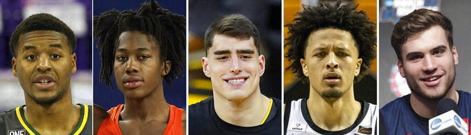 FILE - From left are file photos showing NCAA college basketball players Jared Butler, Baylor; Ayo Dosunmu, Illinois; Luka Garza, Iowa; Cade Cunningham, Oklahoma State and Corey Kispert, Gonzaga. Butler, Dosunmu, Garza, Cunningham and Kispert were selected to The Associated Press All-America first team, Tuesday, March 16, 2021. (AP Photo/File)