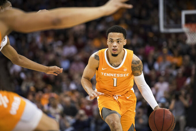Tennessee guard Lamonte Turner (1) dribbles the ball during the second half of an NCAA college basketball game against South Carolina Tuesday, Jan. 29, 2019, in Columbia, S.C. Tennessee defeated South Carolina 92-70. (AP Photo/Sean Rayford)