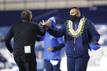 San Diego State head coach Brady Hoke, left, and BYU head coach Kalani Sitake, right, greet each other after an NCAA college football game Saturday, Dec. 12, 2020, in Provo, Utah. (AP Photo/George Frey, Pool)