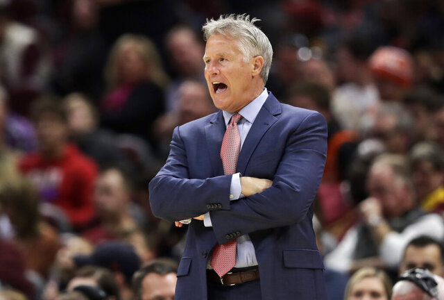 Philadelphia 76ers head coach Brett Brown yells instructions to players in the second half of an NBA basketball game against the Cleveland Cavaliers, Sunday, Nov. 17, 2019, in Cleveland. The 76ers won 114-95. (AP Photo/Tony Dejak)