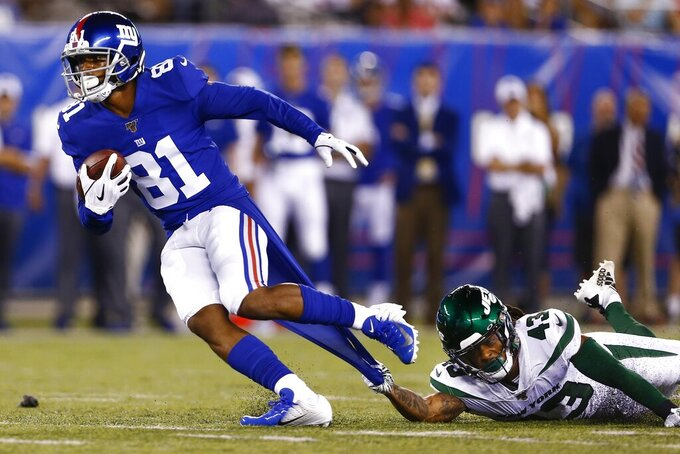 New York Giants' Russell Shepard (81) breaks a tackle by New York Jets' Parry Nickerson (43) during the first half of a preseason NFL football game Thursday, Aug. 8, 2019, in East Rutherford, N.J. Shepard scored a touchdown on the play. (AP Photo/Adam Hunger)