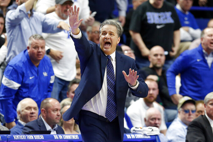 Kentucky coach John Calipari directs his team during the second half of an NCAA college basketball game against Louisville in Lexington, Ky., Saturday, Dec. 28, 2019. Kentucky won in overtime, 78-70. (AP Photo/James Crisp)