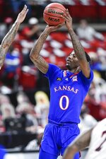Kansas' Marcus Garrett (0) shoots the ball during an NCAA college basketball game against Texas Tech in Lubbock, Texas, Thursday, Dec. 17, 2020. (AP Photo/Justin Rex)