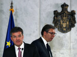 European Union envoy for the negotiations Miroslav Lajcak, left, and Serbian President Aleksandar Vucic arrive for a press conference after talks in Belgrade, Serbia, Monday, June 22, 2020. Europe and the United States are coordinating efforts toward urging Serbia and Kosovo to reach a deal. (AP Photo/Darko Vojinovic)