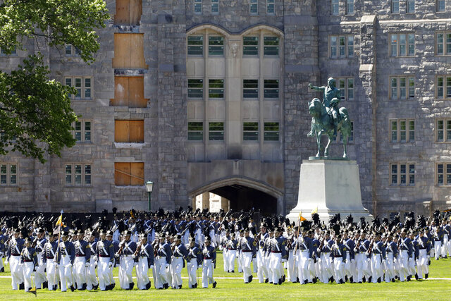 FILE - In this May 22, 2019 file photo, members of the senior class march past a statue of George Washington during Parade Day at the U.S. Military Academy in West Point, N.Y. The 1,106 members of Class of 2020 returned West Point for a graduation ceremony this month amid a pandemic, and at least 15 tested positive for the coronavirus. (AP Photo/Mark Lennihan, File)