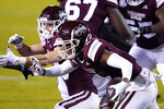 Mississippi State wide receiver Malik Heath, front, carries a pass reception for short gain against Auburn during the first half of an NCAA college football game Saturday, Dec. 12, 2020, in Starkville, Miss. (AP Photo/Rogelio V. Solis)