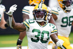 CORRECTS TO GREEN BAY PACKERS RUNNING BACK JAMAAL WILLIAMS NOT HOUSTON TEXANS CORNERBACK CORNELL ARMSTRONG - Green Bay Packers running back Jamaal Williams (30) warms up before an NFL football game against the Houston Texans, Sunday, Oct. 25, 2020, in Houston. (AP Photo/Sam Craft)