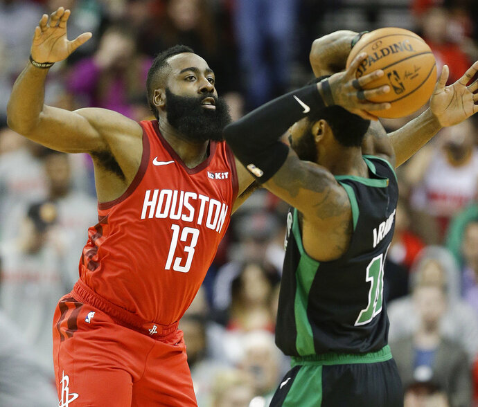 Houston Rockets guard James Harden (13) applies defensive pressure against Boston Celtics guard Kyrie Irving during the first half of an NBA basketball game, Thursday, Dec. 27, 2018, in Houston. (AP Photo/Eric Christian Smith)