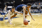 Villanova forward Jeremiah Robinson-Earl, right, and Butler forward Bryce Golden go after a loose ball during the second half of an NCAA college basketball game in Indianapolis, Wednesday, Feb. 5, 2020. Butler won 79-76. (AP Photo/AJ Mast)