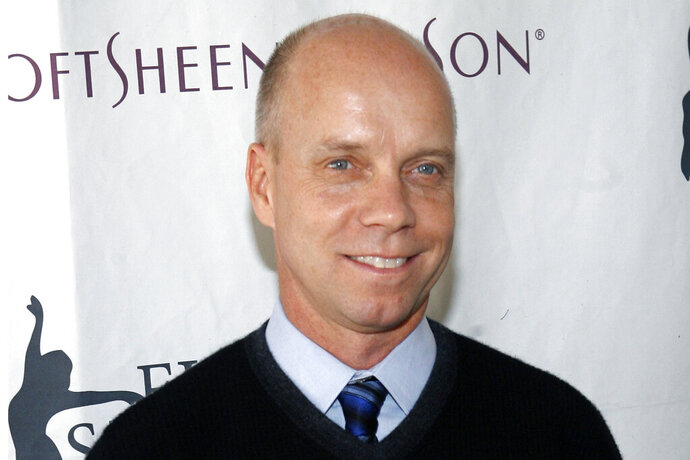 FILE - In this April 9, 2007 file photo, former Olympic figure skating gold medalist Scott Hamilton arrives for Figure Skating In Harlem's annual gala