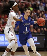 BYU guard Brenna Chase, right, drives as Stanford's Kiana Williams defends during the first half of a second-round game in the NCAA women's college basketball tournament Monday, March 25, 2019, in Stanford, Calif. (AP Photo/Ben Margot)