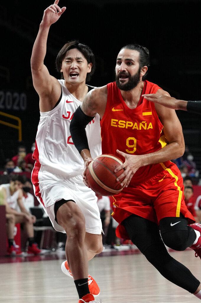Spain's Ricky Rubio (9) drives past Japan's Daiki Tanaka (24) during a men's basketball preliminary round game at the 2020 Summer Olympics in Saitama, Japan, Monday, July 26, 2021. (AP Photo/Eric Gay)