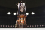 FILE - This July 23, 2020, file photo shows the Olympic flame in a lantern, after the