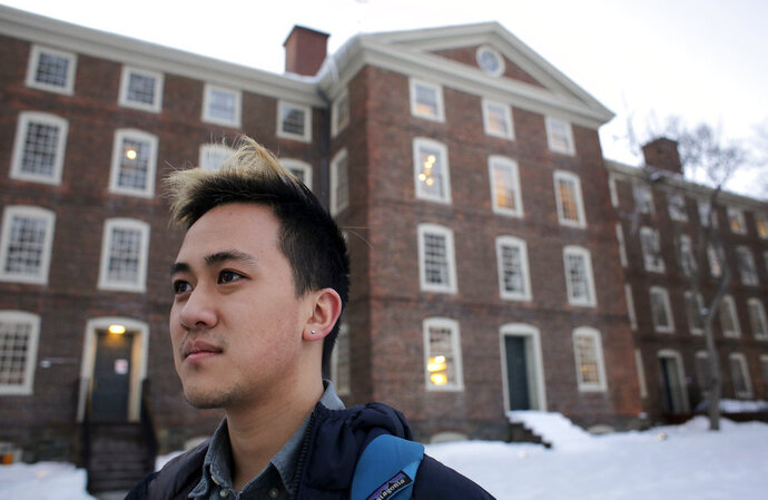 FILE - In this Feb. 14, 2017 file photo, Viet Nguyen poses for a portrait on the Brown University campus in Providence, R.I. Nguyen, now an alumnus, helped lead an effort urging Brown and other elite universities to rethink their legacy admissions policies. (AP Photo/Steven Senne, File)