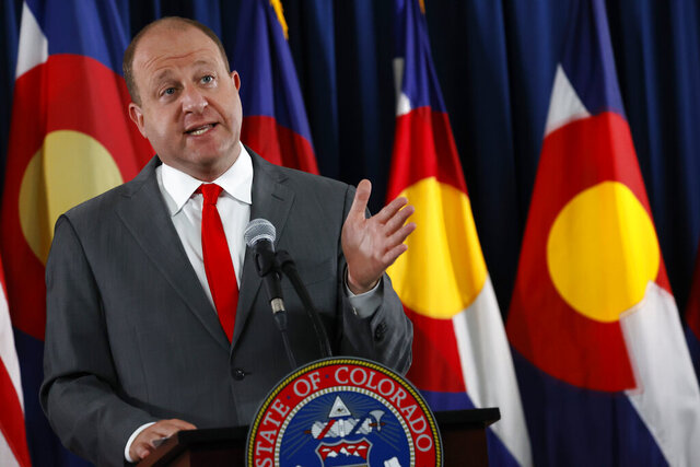 Colorado Governor Jared Polis makes a point during a news conference to update the state's status in dealing with the new coronavirus Tuesday, July 28, 2020, in Denver. (AP Photo/David Zalubowski)