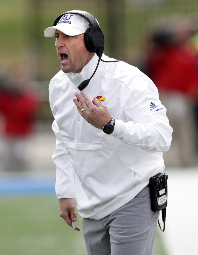 Kansas head coach David Beaty yells to his team during the second half of an NCAA college football game against Iowa State in Lawrence, Kan., Saturday, Nov. 3, 2018. (AP Photo/Orlin Wagner)