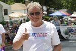 In this July 4, 2018, photo, then-Democratic gubernatorial candidate and former state Sen. Bob Krist gives the thumbs-up as he campaigns during a Fourth of July parade in Ralston, Neb. Krist recently endorsed Republican Rep. Don Bacon over his own party's Kara Eastman for the state's only competitive congressional seat. (AP Photo/Nati Harnik)