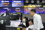 Currency traders watch monitors at the foreign exchange dealing room of the KEB Hana Bank headquarters in Seoul, South Korea, Thursday, Nov. 14, 2019. Asian stock markets were mixed Thursday amid doubts about the status of a U.S.-Chinese trade deal after the U.S. Federal Reserve's chairman said it is likely to leave its benchmark interest rate unchanged. (AP Photo/Ahn Young-joon)