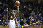 Duke center Vernon Carey Jr. (1) shoots while Pittsburgh forward Abdoul Karim Coulibaly (12) defends during the second half of an NCAA college basketball game in Durham, N.C., Tuesday, Jan. 28, 2020. (AP Photo/Gerry Broome)