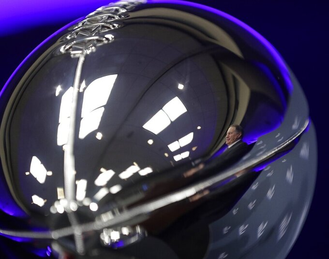 New England Patriots head coach Bill Belichick is reflected in the Lombardi trophy at a news conference for the NFL Super Bowl 53 football game Monday, Feb. 4, 2019, in Atlanta. The Patriots beat the Los Angeles Rams 13-3. (AP Photo/David J. Phillip)