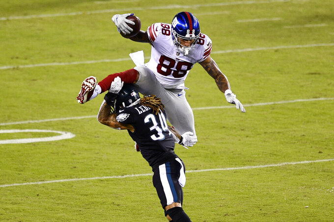 New York Giants' Evan Engram (88) tries to leap over Philadelphia Eagles' Cre'Von LeBlanc (34) during the second half of an NFL football game, Thursday, Oct. 22, 2020, in Philadelphia. (AP Photo/Derik Hamilton)