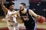Virginia's Jay Huff (30) drives past Boston College's Demarr Langford Jr. (15) during the first half of an NCAA college basketball game, Saturday, Jan. 9, 2021, in Boston. (AP Photo/Michael Dwyer)