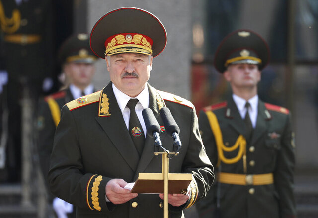 Belarusian President Alexander Lukashenko delivers a speech during his inauguration ceremony at the Palace of the Independence in Minsk, Belarus, Wednesday, Sept. 23, 2020. Lukashenko of Belarus has assumed his sixth term of office in an inauguration ceremony that wasn't announced in advance. State news agency BelTA reported that Wednesday's ceremony is taking place in the capital of Minsk, with several hundred top government official present. (Maxim Guchek, BelTA/Pool Photo via AP)