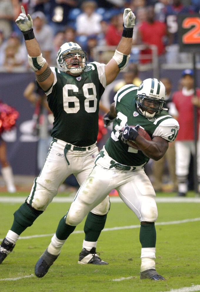 FILE - In this Oct. 19, 2003, file photo, New York Jets' Kevin Mawae (68) signals a touchdown as running back LaMont Jordan (34) dances into the end zone for the winning touchdown during the fourth quarter against the Houston Texans, in Houston. Mawae will be inducted into the Pro Football Hall of Fame in Canton, Ohio on Aug. 3, 2019. (AP Photo/David J. Phillip, File)