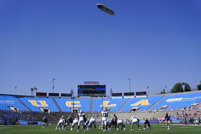 The Goodyear blimp flies above the Rose Bowl as Hawaii plays UCLA during the second half of an NCAA college football game Saturday, Aug. 28, 2021, in Pasadena, Calif. (AP Photo/Ashley Landis)