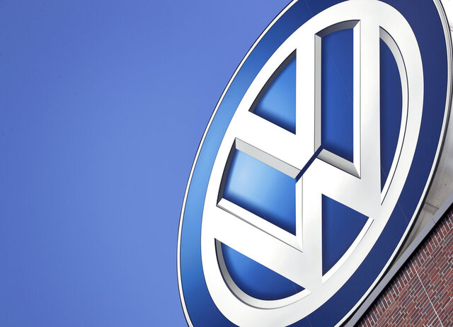 FILE - In this Wednesday, Aug. 1, 2018, file photo a logo of the car manufacturer Volkswagen is pictured on top of a company building in Wolfsburg, Germany. (AP Photo/Michael Sohn, file)