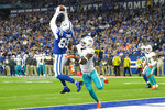 Indianapolis Colts tight end Eric Ebron (85) makes a catch in the end zone over Miami Dolphins defensive back Steven Parker (26) during the first half of an NFL football game in Indianapolis, Sunday, Nov. 10, 2019. The play was rule an interception by Parker. (AP Photo/AJ Mast)