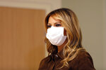 First lady Melania Trump wears a mask as she stands in a simulation lab at Concord Hospital, Thursday, Sept. 17, 2020, in Concord, N.H. (AP Photo/Mary Schwalm)