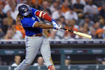 Toronto Blue Jays' Vladimir Guerrero Jr. singles against the Detroit Tigers during the fifth inning of a baseball game Friday, Aug. 27, 2021, in Detroit. (AP Photo/Jose Juarez)