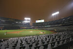 RingCentral Coliseum stands under skies darkened by wildfire smoke during the Oakland Athletics' baseball game against the Houston Astros in Oakland, Calif., Wednesday, Sept. 9, 2020. (AP Photo/Jed Jacobsohn)