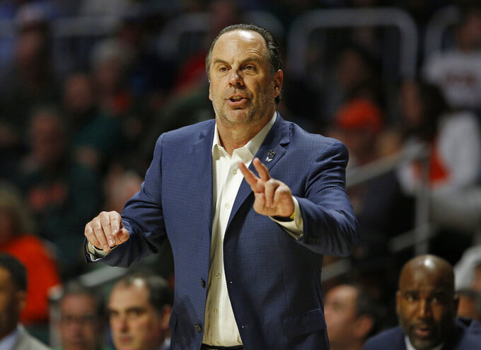 Notre Dame head coach Mike Brey gives instructions to his team during the first half of an NCAA college basketball game against Miami, Wednesday, Feb. 6, 2019 in Coral Gables, Fla. (David Santiago/Miami Herald via AP)