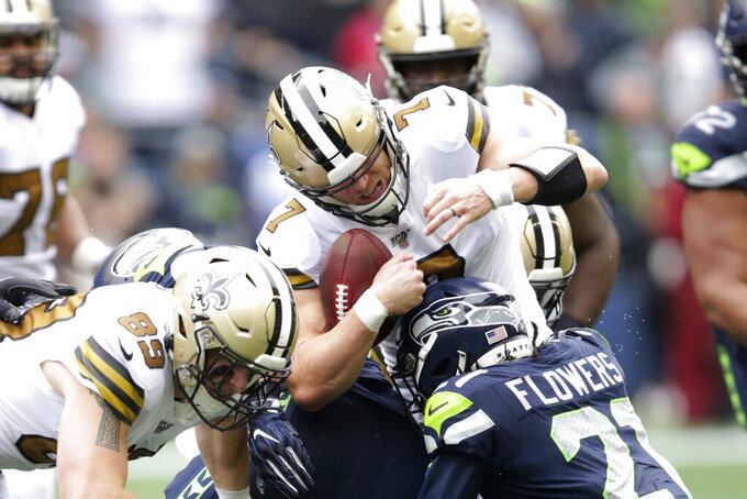 New Orleans Saints' Taysom Hill (7) carries against the Seattle Seahawks during the second half of an NFL football game, Sunday, Sept. 22, 2019, in Seattle. (AP Photo/Scott Eklund)