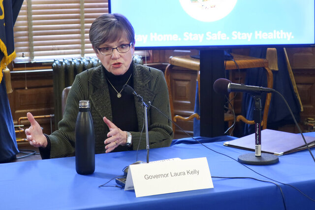 Kansas Gov. Laura Kelly answers questions about the coronavirus outbreak in her state during a news conference, Wednesday, April 1, 2020, at the Statehouse in Topeka, Kan. Kelly says the state is in the