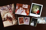Photographs of Jacob Olivas as a child lie on the dining room table in Rancho Cucamonga, Calif., on Saturday, Sept. 28, 2019. When he was little he'd skip school and go to Mount Baldy to gather his thoughts and years later, he rented a cabin near its ski lodge. It is still the only place Olivas feels safe being alone. (AP Photo/Wong Maye-E)