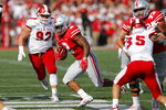 Ohio State running back J.K. Dobbins, center, cuts up field between Miami (Ohio) defenders on his way to scoring a touchdown during the first half of an NCAA college football game Saturday, Sept. 21, 2019, in Columbus, Ohio. (AP Photo/Jay LaPrete)