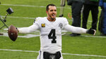 Las Vegas Raiders quarterback Derek Carr celebrates after the Raiders defeated the Cleveland Browns 16-6 in an NFL football game, Sunday, Nov. 1, 2020, in Cleveland. (AP Photo/Ron Schwane)