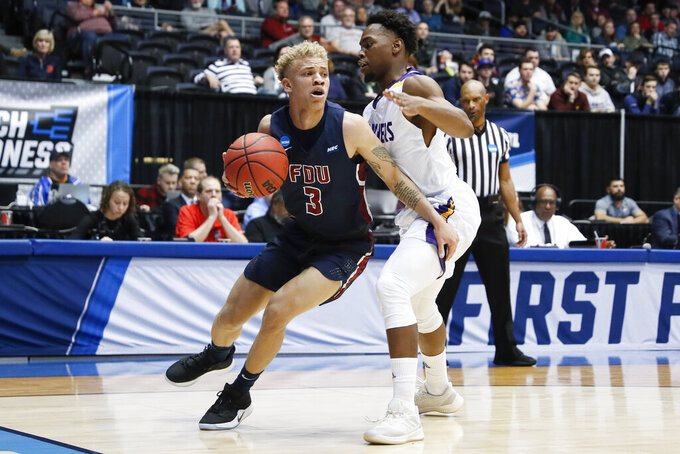 Fairleigh Dickinson's Jahlil Jenkins (3) drives against Prairie View A&M's Taishaun Johnson, right, during the first half of a First Four game of the NCAA college basketball tournament, Tuesday, March 19, 2019, in Dayton, Ohio. (AP Photo/John Minchillo)