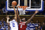 Duke guard Cassius Stanley (2) shoots while North Carolina State forward D.J. Funderburk (0) defends during the first half of an NCAA college basketball game in Durham, N.C., Monday, March 2, 2020. (AP Photo/Gerry Broome)