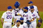 New York Mets' Dominic Smith (2) congratulates Pete Alonso (20) as relief pitcher Edwin Diaz, upper right, celebrates with Robinson Chirinos (26) after the Mets' 7-6 victory over the Baltimore Orioles in a baseball game, Wednesday, Sept. 9, 2020, in New York. (AP Photo/Kathy Willens)