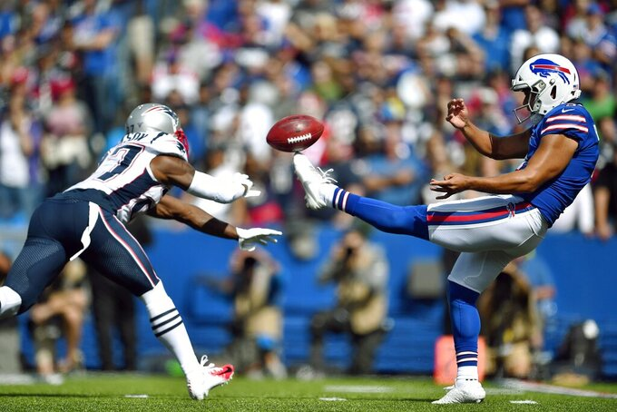 New England Patriots defensive back J.C. Jackson, left, blocks a punt by Buffalo Bills punter Corey Bojorquez in the first half of an NFL football game, Sunday, Sept. 29, 2019, in Orchard Park, N.Y. (AP Photo/Adrian Kraus)