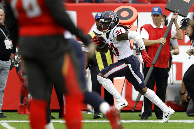 Houston Texans cornerback Bradley Roby (21) runs back an interception by Tampa Bay Buccaneers quarterback Jameis Winston for a score during the first half of an NFL football game Saturday, Dec. 21, 2019, in Tampa, Fla. (AP Photo/Chris O'Meara)