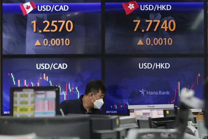 A currency trader watches monitors at the foreign exchange dealing room of the KEB Hana Bank headquarters in Seoul, South Korea, Thursday, April 1, 2021. Asian stock markets followed Wall Street higher Thursday after Japan and South Korea reported unexpectedly strong economic data and President Joe Biden announced a $2.3 trillion U.S. infrastructure spending plan. (AP Photo/Ahn Young-joon)